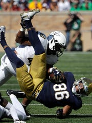 Vanderbilt linebacker Jordan Griffin tackles Notre Dame tight end Alize Mack (86) during their game this season.