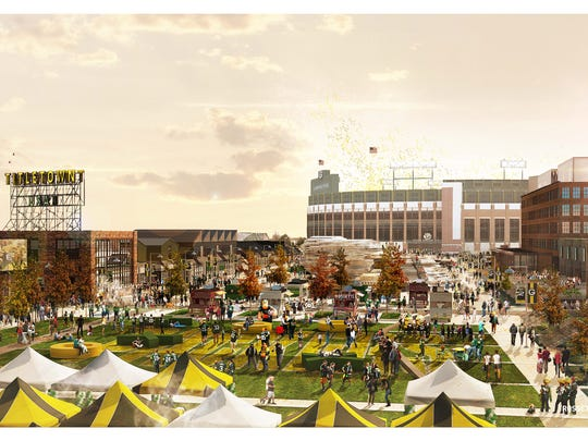 An artist's conceptual rendering shows a fall scene in the Titletown District's public plaza, with Lambeau Field in the background. Final designs might differ.