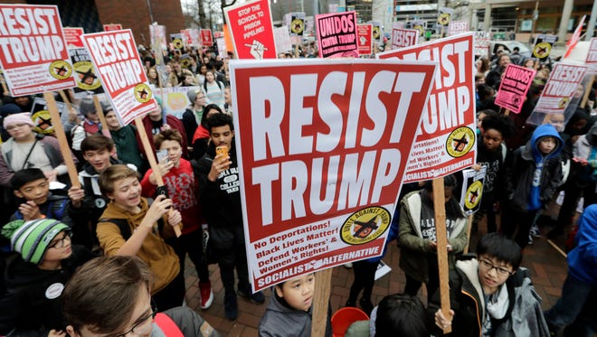 High school and college student protesters marking Inauguration Day demonstrate at Seattle Central College, Friday, Jan. 20, 2017, in Seattle. (AP Photo/Elaine Thompson)