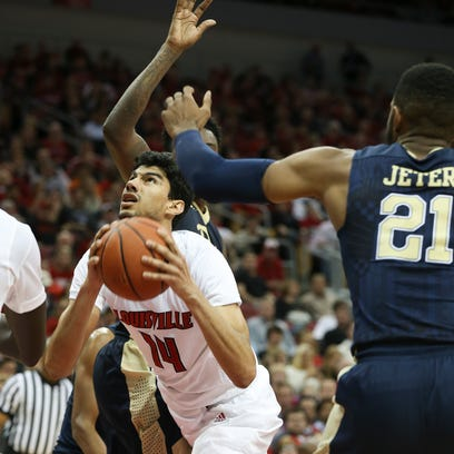 U of L's Anas Mahmoud (14) looked for room to operate