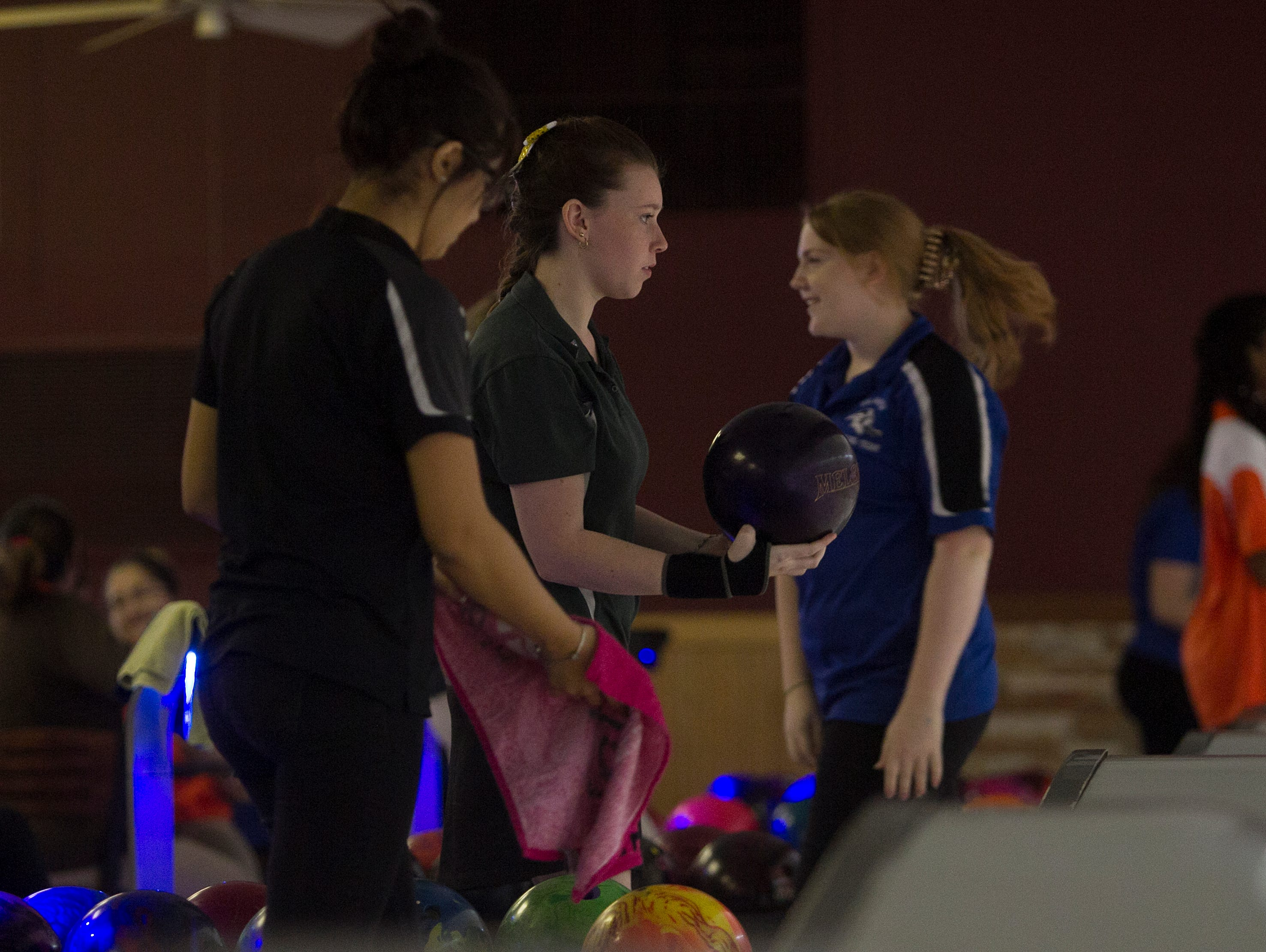 Island Coast's Mikayla Simer, center, eyes the lane while bowling at the District 6 bowling tournament Tuesday at Bowland in Cape Coral.