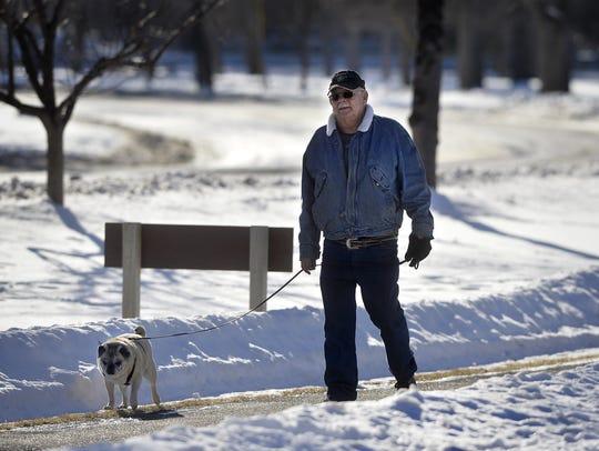 Robert Paranteau walks his dog Bandit at Gibson Park this past winter