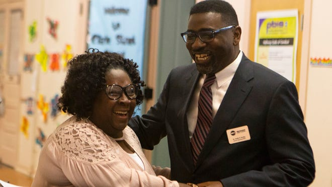 MPS Superintendent Keith Posley meets with substitute secretary Diane Green at Clarke St. Elementary School in May.