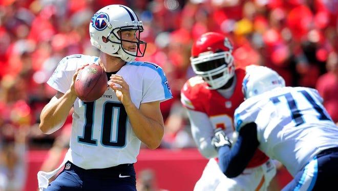 Titans quarterback Jake Locker looks to pass during the second quarter Sunday at Arrowhead Stadium.