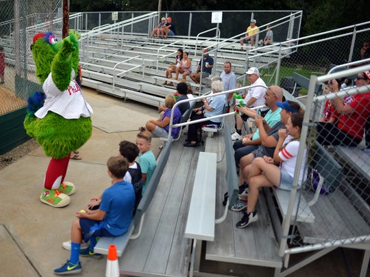 The Phillie Phanatic gets a warm reception from fans during the Bridgeton Invitational last year at Alden Field in Bridgeton.