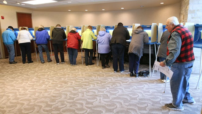 April 5, 2016 Voters voting at the Menomonee Falls Public Library on Pilgrim Road.  Voters marking their ballots had all the balloting stations filled. MICHAEL SEARS/MSEARS@JOURNALSENTINEL.COM