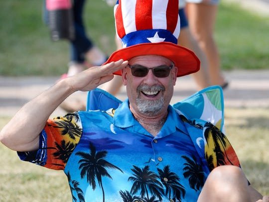 Bruce Burlager, 58, of Troy salutes during the parade.