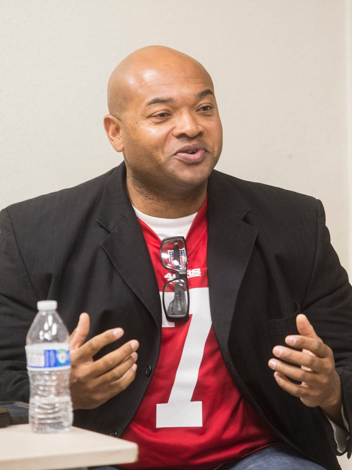 Waymond Fermon speaks during a panel discussing President Donald Trump and the National Football League hosted by the Democratic Women of the Desert at the James O. Jessie center in Palm Springs on November 14, 2017.