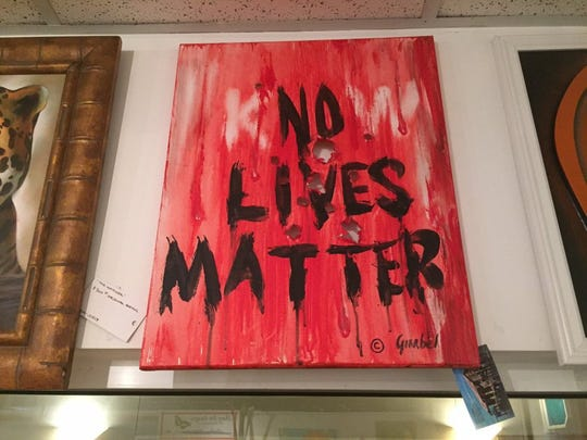 "Vero Beach artist Bill Gimbel was asked to remove his ""KnoW Lives Matter"" painting from the Main Street Vero Beach gallery Jan. 4, after two patrons complained. Gimbel resigned from the gallery, calling the request ""censorship."" What do you think of the painting? Take our poll at TCPalm.com. (LAURENCE REISMAN/TREASURE COAST NEWSPAPERS)"