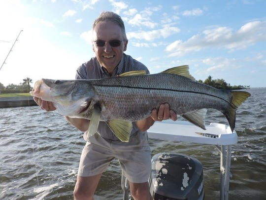 CHRIS BRITTON/CONTRIBUTED PHOTO This happy angler bagged a slot snook while fishing with a live mullet in the Indian River Lagoon near Stuart with Capt. Chris Britton of Grey Ghost charters in Stuart. Could eating a snook caught in the St. Lucie River or Caloosahatchee River, when season is open, one day be a health risk?