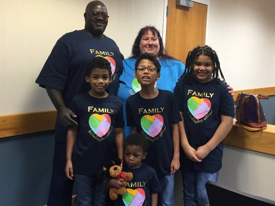 Henry and Melanie Ford with their four adopted children: 9-year-old Henry, 11-year-old Franklin, 8-year-old Laurilye, and 2-year-old Khion