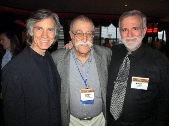 MAD magazine cartoonist Sergio Aragonés, center, poses with cartoonist Greg Evans, left, and art director Sam Viviano at the National Cartoonists Society Convention dinner in May. (Michael Donahue/The Commercial Appeal)