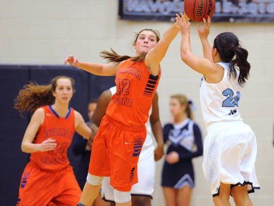 William Blount's Taylor Goforth (42) reaches to block a shot by Hardin Valley's Paige Gentry (24) during a high school basketball game at Hardin Valley Academy on Thursday, Jan. 7, 2016.