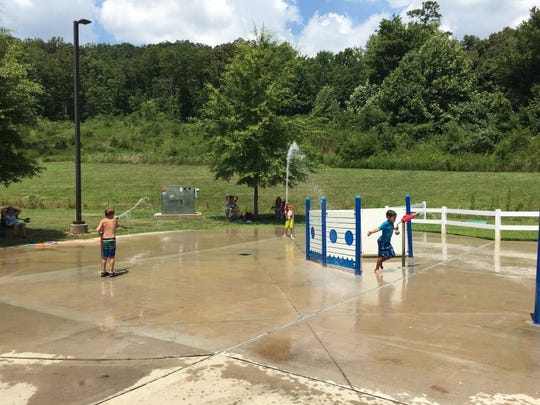 A water cannon war at New Harvest Park splash pad, 4775 New Harvest Lane.