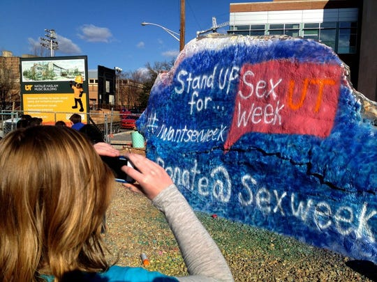 Sex Week co-founder Brianna Rader photographs a finished painting of The Rock on March 21, 2013, at the University of Tennessee.