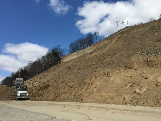 Tennessee Department of Transportation workers continue work on a rock slide on Interstate 75 North in Campbell County on Monday, March 21, 2016. (Submitted by TDOT).