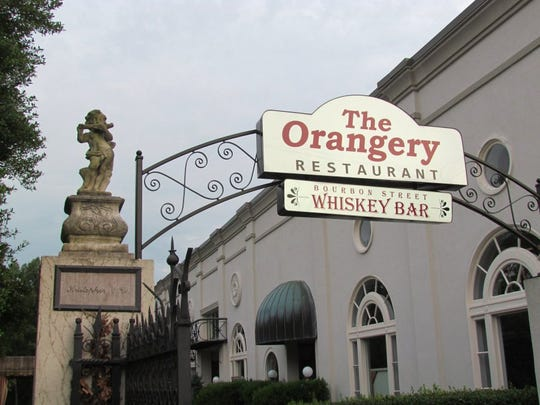 The entrance to The Orangery is lit up on Monday, June