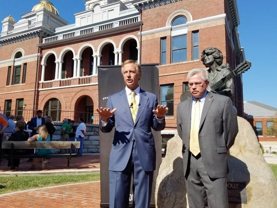 Gov. Bill Haslam, left, announces record tourism spending revenues for Tennessee with Commissioner of Tourism Development Kevin Triplett on Aug. 30, 2016, at the Sevier County Courthouse. The courthouse has 16 entrance doors, most open to the public, and no stationary metal detectors.