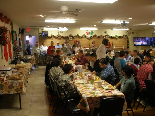 CONTRIBUTED PHOTOS/Harry Thomas Servicemen and women sit down to a Christmas dinner at San Angelo Elks Lodge No. 1880 on Dec. 25. San Angelo Elks and community volunteers worked the day serving meals.