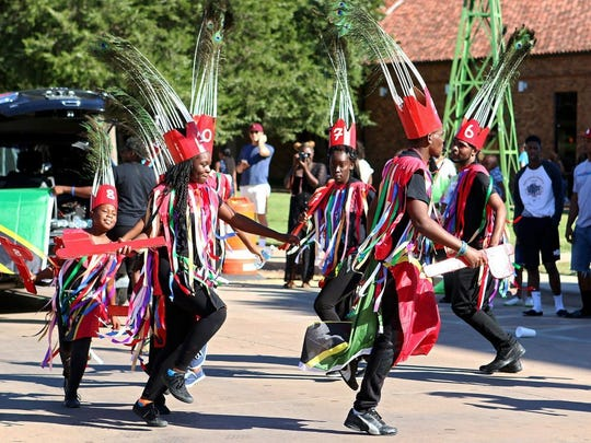 Patrick Johnston/Times Record News A group participates in the parade during the Midwestern State University Caribbean Students Organization's annual Caribfest Saturday afternoon on the MSU campus. The three-day festival wrapped up Saturday with the parade, an authentic Caribbean meal and a Glow Fete.