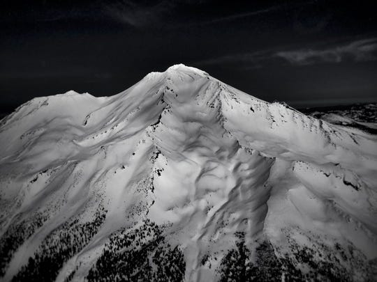 File photo - Mt. Shasta is seen with a thick blanket of snow. (Photo by Jimmy Williams)