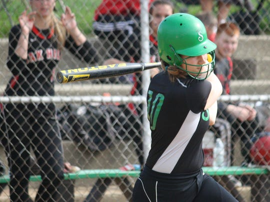 Seton's Jess Beeler fights off a pitch foul against Oak Hills last May. She was voted Enquirer Preps Ohio Athlete of the Week for April 17-23.