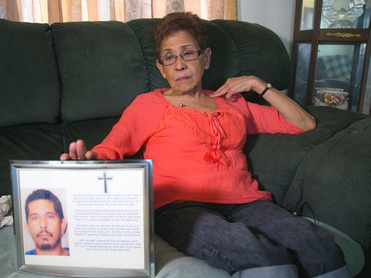 Doris Yamashita Concepcion holds a photograph of her son Joseph Anthony Quinata at her home in Prescott, Ariz., She alleges that her son  confessed to being molested by Archbishop Anthony Apuron just before he went into surgery for intestinal perforation in 2005. He did not survive the surgery. Quinata was 38 when he died.
