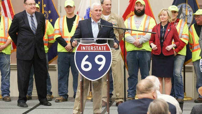 Gov. Mike Pence spoke during ceremonies for the opening of Section 4 of I-69 on Dec. 9, 2015.