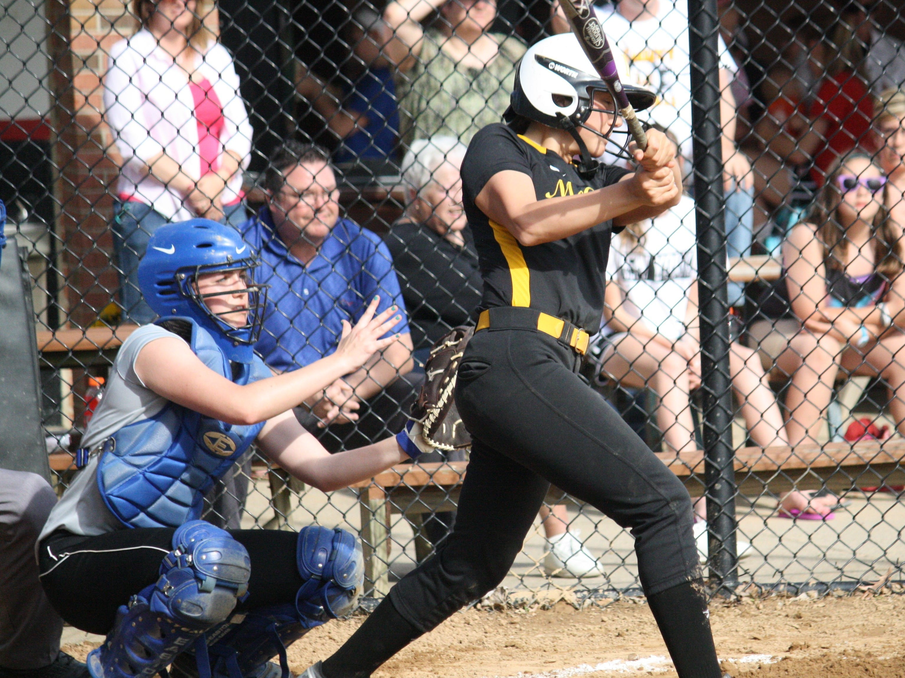 McAuley sophomore Britney Bonno connects for a double against Mercy on April 17 at St. James Field.