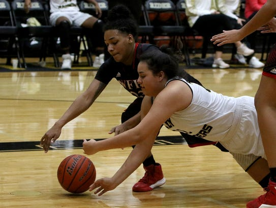 Wichita Falls High School's Di Ondrea Sanders, left, and Rider's Rylee Torres scramble for a loose ball in December 2017. Both girls were selected to the Oil Bowl all-star basketball game.