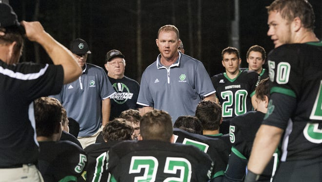 Mountain Heritage football coach Joey Robinson and the Cougars have moved their latest home game to North Buncombe.