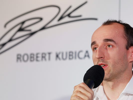 F1 reserve driver for Williams, Robert Kubica who almost lost his right hand in a 2011 rally crash, talks to reporters about his motivation for the comeback and his dream of returning to racing, in Warsaw, Poland, Thursday, March 29, 2018. (AP Photo/Czarek Sokolowski)