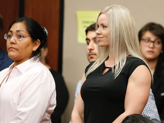Mistie Lopez, wife of defendant Hisaias Justo Lopez, smiles at her husband at the end of closing arguments in the trial in which he was accused of fatally stabbing Border Patrol Agent Isaac Morales. Morales was fatally stabbed May 20, 2017, in the parking lot of the Union Draft House in far East El Paso.