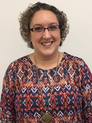 """Shannon Montgomery, the art teacher at Heath's Stevenson Elementary, was the district's winner for the annual """"You Made a Difference"""" award, which is given to teachers across the county."""