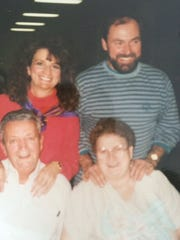 Marie Nelson with with husband Gary and her parents.
