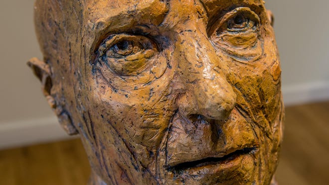 A closeup of a head sculptor by artist Marlene Miller reveals some intricate detail work and textures. Some of Miller's work is on display through the end of September at Exhibit A Gallery in Peoria Heights.