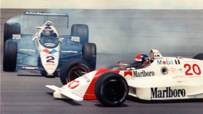 In one of the most dramatic finishes in 500 history, Al Unser (2) and Emerson Fittipaldi touched wheels as they entered turn three side-by-side on lap 199. Unser's car spun out of control and hit the wall; Fittipaldi went on to win the race.  Star file photo <b>05/21/2011 - P04 - MAIN - 1ST - THE INDIANAPOLIS STAR</b><br />In one of the most dramatic finishes in 500 history, Al Unser Jr.  (2) and Emerson Fittipaldi touched wheels on lap 199 in 1989. Unser's car hit the wall; Fittipaldi went on to win the race.