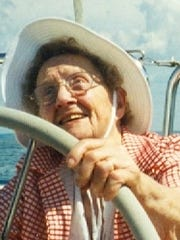 Noella Howlett, shown steering a sailboat, was an avid outdoor enthusiast throughout her life.