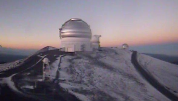 Light snow covered the high elevation slopes at Mauna Kea, Hawaii, Tuesday June 14, 2016.