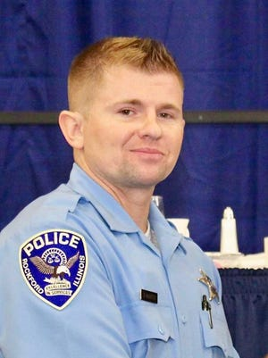 Rockford police officer Dominik McNiece, pictured in 2013 after graduating from police academy, was identified on Monday as the officer who shot a man after a pursuit on Friday.