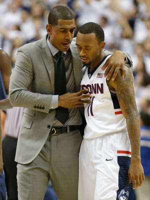 Connecticut coach Kevin Ollie advises guard Ryan Boatright in the Huskies' season-opening win vs. Bryant.