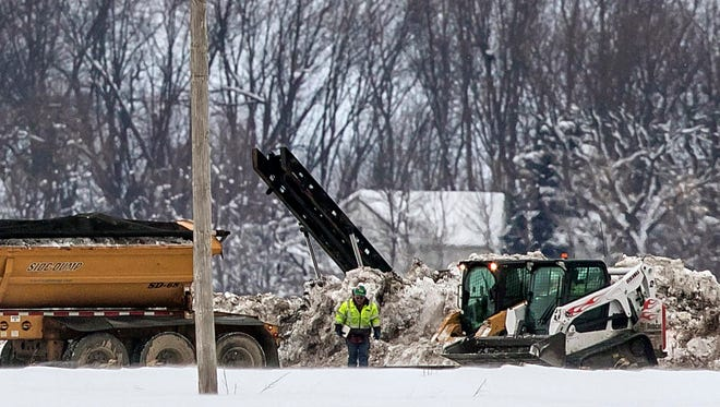 Crews work Thursday, Jan. 26, 2017, to clean up a diesel fuel spill after a pipeline owned by Magellan Midstream Partners broke at about 8 a.m. near Hanlontown, Iowa, a day earlier.