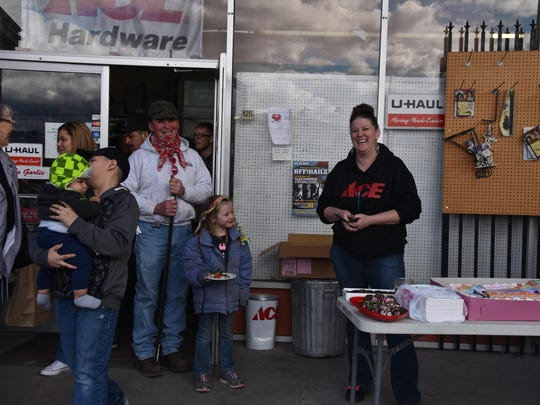 Cheryl Giomi, right, greets well-wishers at Giomi's Ace Hardware during the store's 45th anniversary celebration last Saturday in Yerington.