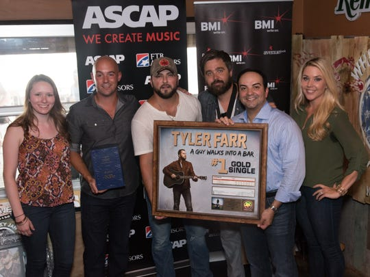 "Mike Molinar, far right, stands with country singer Tyler Farr who recorded a No. 1 single with ""A Guy Walks into a Bar."" Molinar has been pitching songs as part of his job for many years."