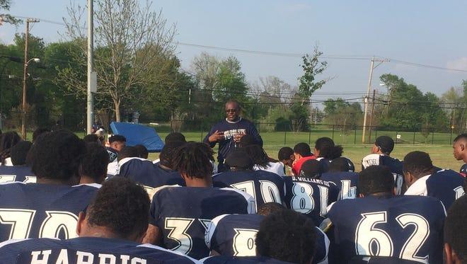 JSU coach Tony Hughes addresses his team following practice on Tuesday.