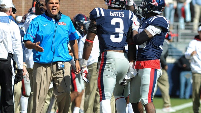 Ole Miss Rebels head coach Matt Luke and Mississippi Rebels linebacker DeMarquis Gates (3) celebrate during the first half against the Arkansas Razorbacks at Vaught-Hemingway Stadium. Mandatory Credit: Justin Ford-USA TODAY Sports