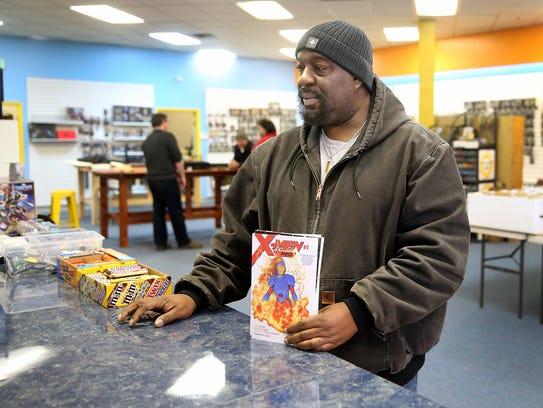 Regular customer George David of Bremerton buys comics