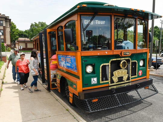 Passengers board a trolley outside the St. Cloud City Hall Friday, July 21, for a 90-minute tour around town hosted by Mayor Dave Kleis.