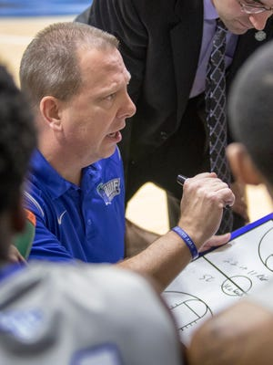 Argonauts head coach Jeff Burkhamer goes over some strategy during a timeout during the men's basketball game against Shorter University at the University of West Florida on Saturday, February 25, 2017.