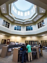 Computers are installed in the library at the new LAMP High School in Montgomery, Ala. on Thursday August 3, 2017.